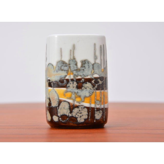 This small ceramic vase or decorative object is part of the Baca series by Ivan Weiss for Royal Copenhagen.
