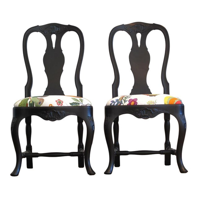 A Pair of Swedish Rococo Chairs with Josef Frank Fabric Josef Frank for Svenskt Tenn fabric ('Baranquilla') on matt black...
