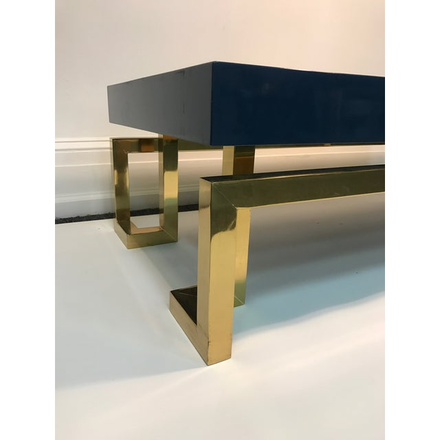 """Exceptional Italian coffee table with Greek key design, late 20th century. Measuring 24"""" by 48"""", 15"""" high. Wood with brass..."""