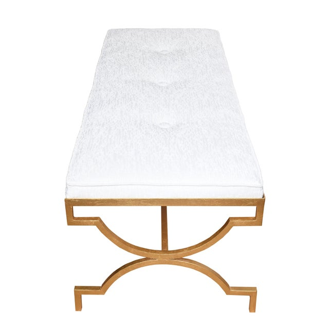 This classic and timeless bench that is attributed to Tommi Parzinger has been fully restored with new real gold leaf...