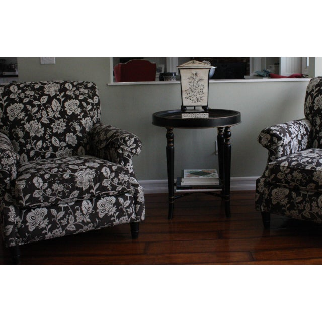 Pair of Basset Chairs covered in a custom designer fabric with a black & cream floral print. These chairs are gently used...