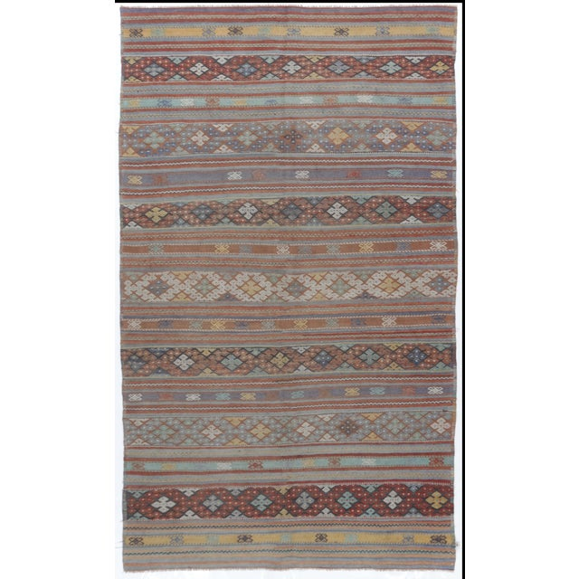 This vintage Turkish flat weave Kilim rug was hand-woven in the 1940s. The simplicity and boldness of these pieces can...