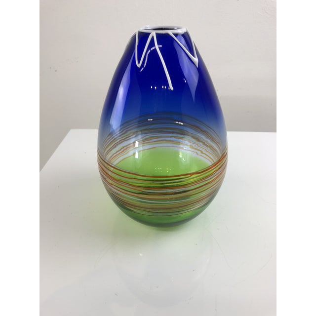 Multiple applied techniques leads to this beautifully designed and uniquely styled vase with vibrant colors and applied...