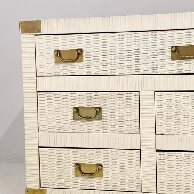 Lovely piece- perfect for Palm Beach or Hollywood Regency setting. Drawer fronts are painted woven wicker. Sides of case...