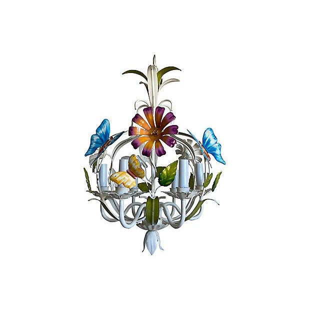 Airy midcentury Italian tole six-arm butterfly garden chandelier with colorful butterflies, flowers and leaves in its...