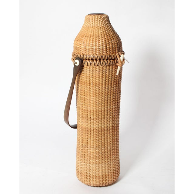 Rare and originally shaped Nantucket lightship basket, with lid and wooden handle in impeccable vintage condition with no...
