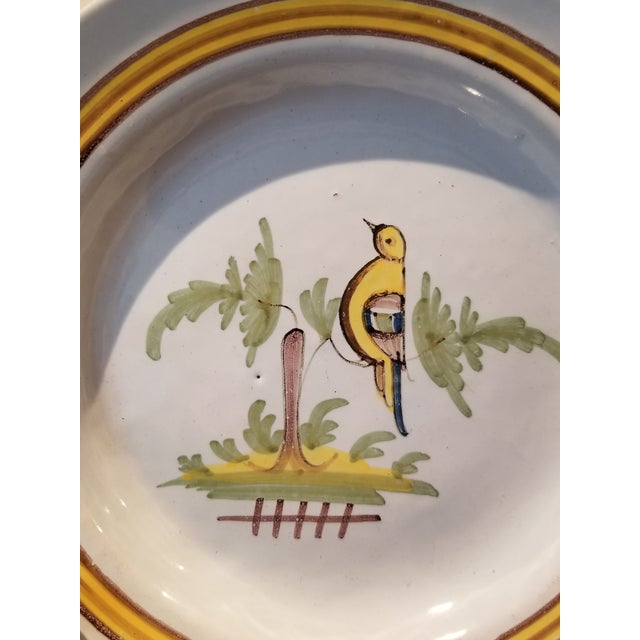 Collectible antique faience pottery (circa 1741) created in Rouen, France. This plate and beer stein are authentic...