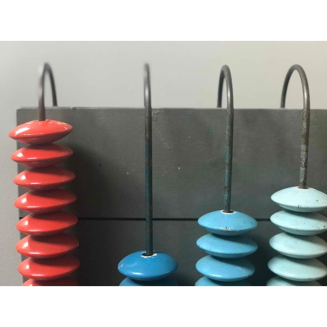 Mid-century multicolor abacus from France.