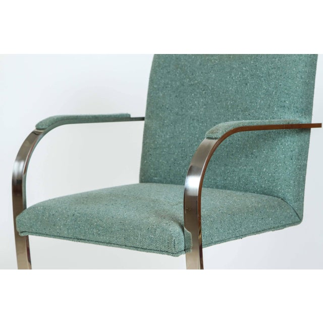 Pair of Ludwig Mies van der Rohe flat bar chairs for Knoll. Polished flat stainless steel frames upholstered in a Harris...