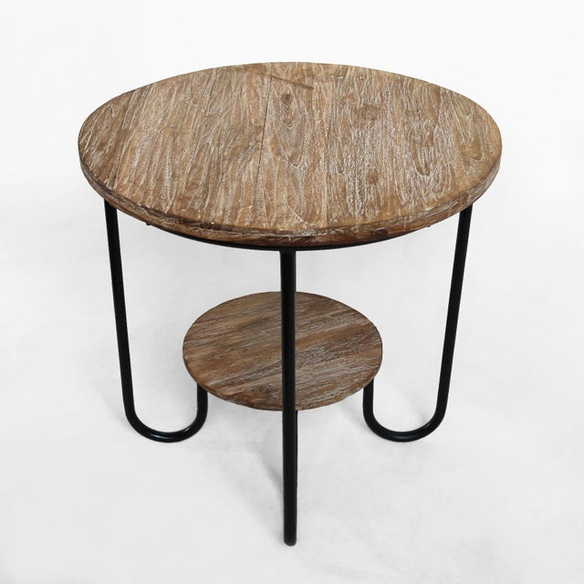 Vintage deco teak side table with white wash finish and black matte iron base. This unique side table works great indoors...