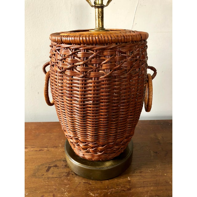 """Vintage double handle ginger jar form wicker table lamp. Measures 12.5"""" to the top of the jar."""