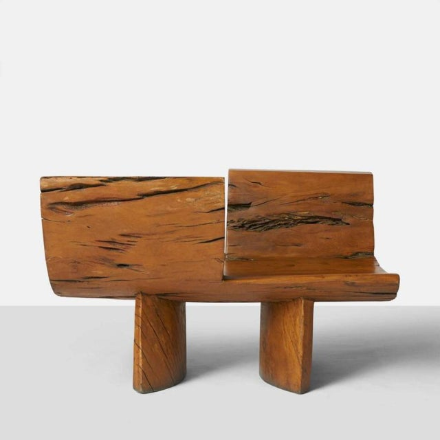 A Tete-a-Tete by Hugo Franca made of naturally fallen Brazilian hardwood trees. The design is made of opposing seats on...