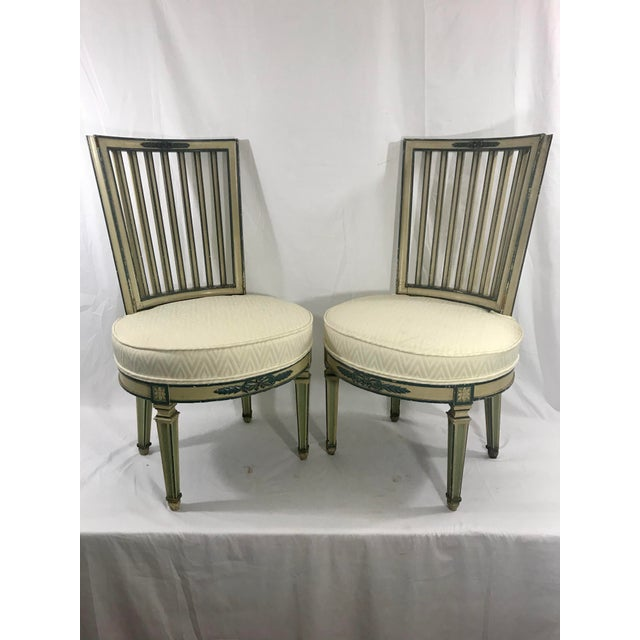 Charming set of 1950s painted Italian Classical dining chairs, two arms and two side chairs. These don't necessary need to...
