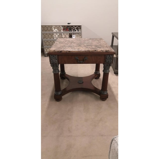 High quality construction. Impressive solid wood table with thick marble or granite. Features mahogany empire base w....