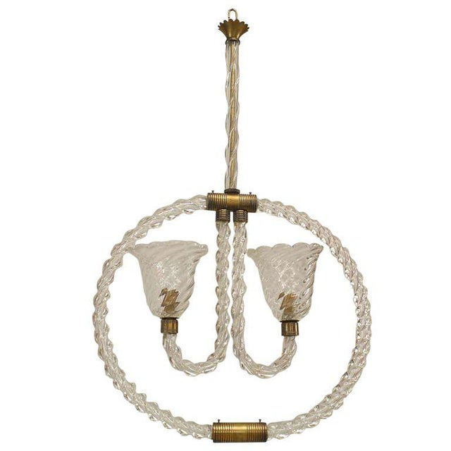 1940's French chandelier featuring a suspended hoop composed of clear Barovier e Toso Murano glass and brass trim that...