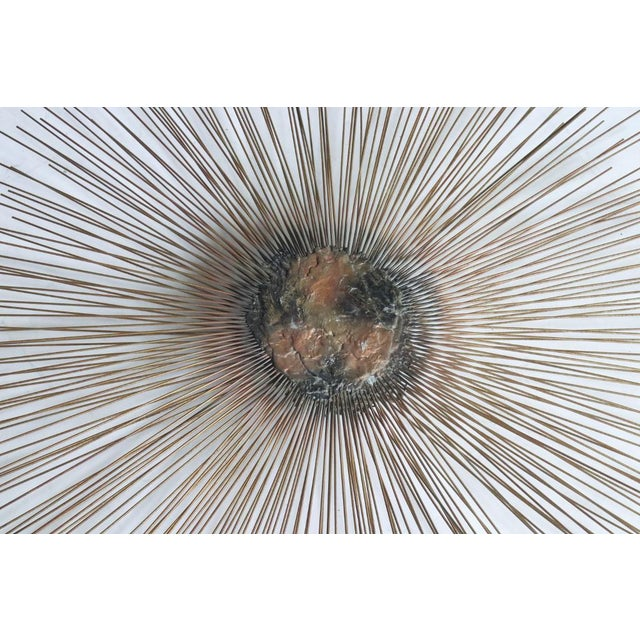 "Sunburst wall sculpture by brothers William and Bruce Friedle measures 38"" diameter made of brass metal rods protruding..."