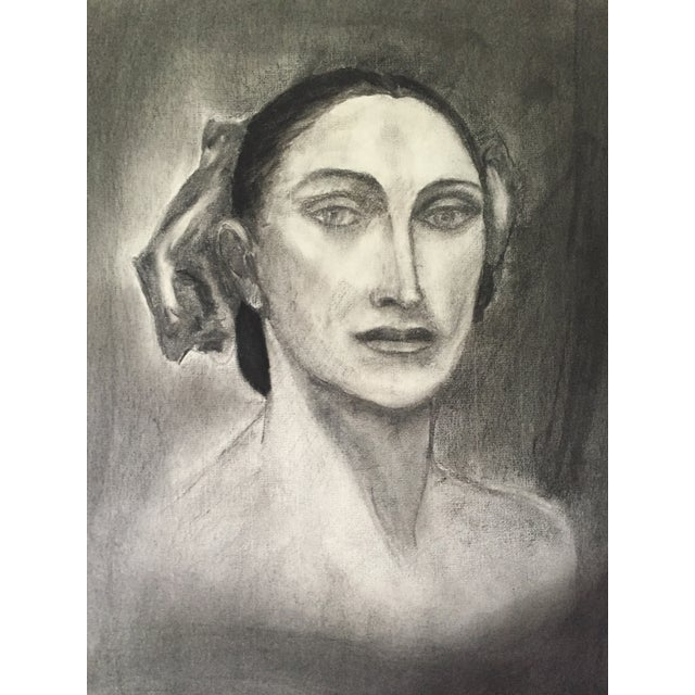 Vintage, stylized charcoal drawing of a woman. From an artists portfolio of works dated 1950.