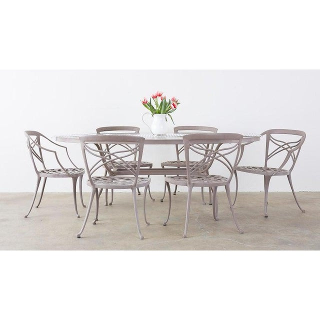 Graceful set of six patio garden dining chairs made in the neoclassical style by Brown Jordan. Features an aluminium...