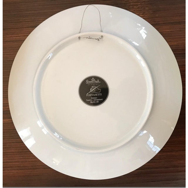 Amongst the most sought after, the Clock Plate by Piero Fornasetti is the one to collect , showing in black a clock with...