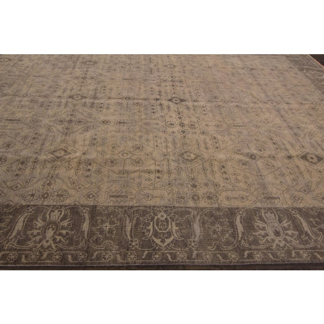 Hand-knotted Oushak rug made in late 20th century India, built with an allover designs. This piece has magnificent...