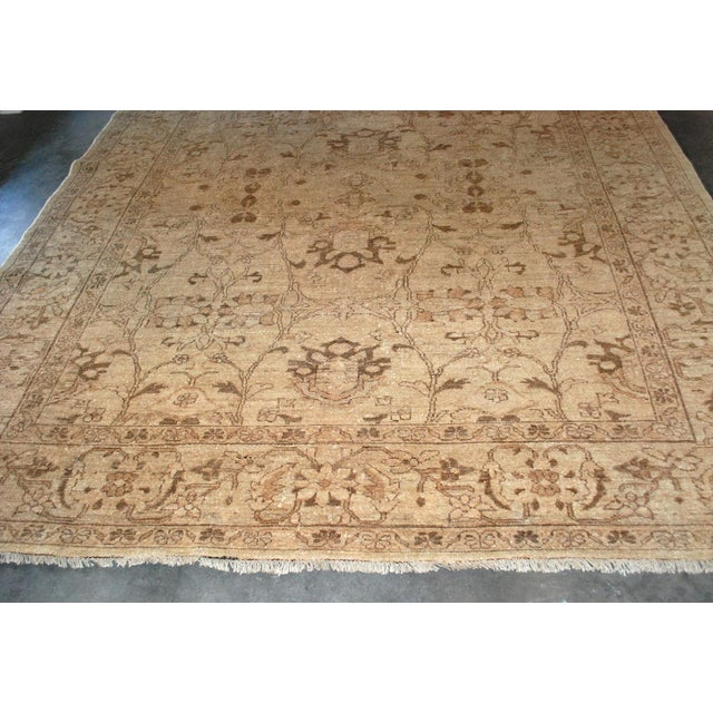 Vintage hand-knotted wool rug in a tonal wheat, gold and brown overall pattern. Slightly longer than square, solid wool.