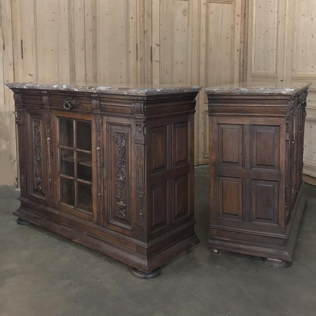 Pair 19th Century French Louis XIV Marble Top Display Buffets features elaborate architectural detail on the cornerposts...