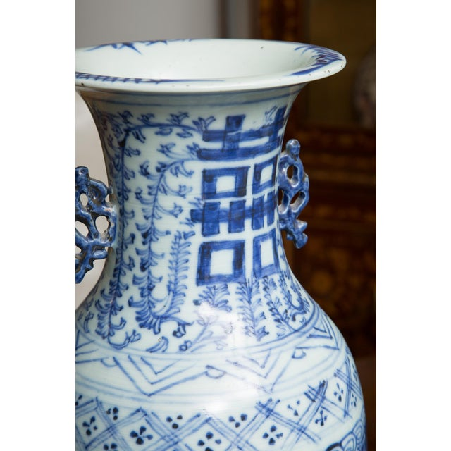 This is a quality pair of Chinese blue and white vases depicting the Chinese symbols for happiness. Mid to late 19th century.