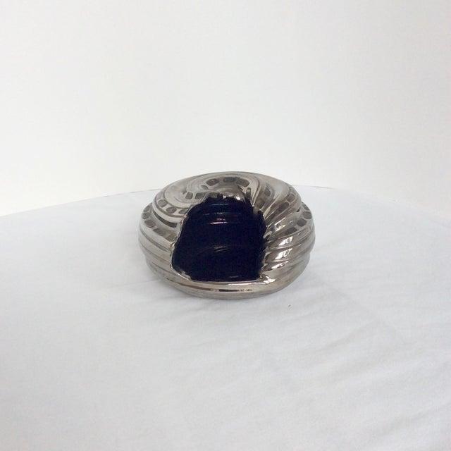 Vintage Italian shell shaped objet with platinum glaze.... and black interior.
