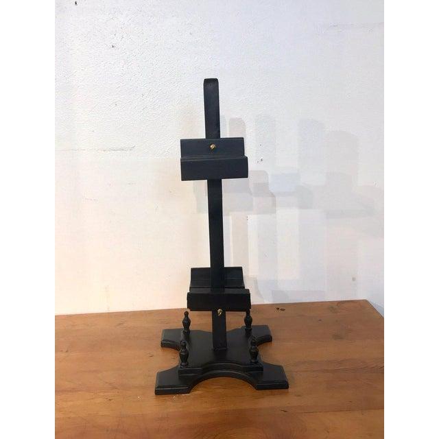 """Regency style ebonized dual sided table easel, 12"""" square base."""