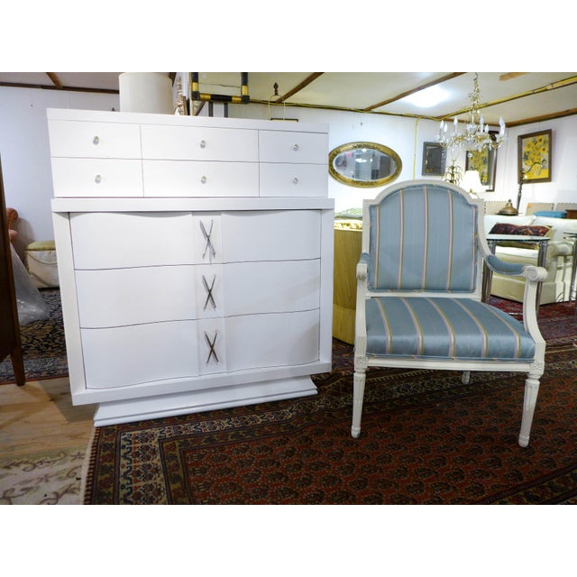A Mid-century Modern chest of drawers that has been newly painted professionally. First quality construction, high grade...