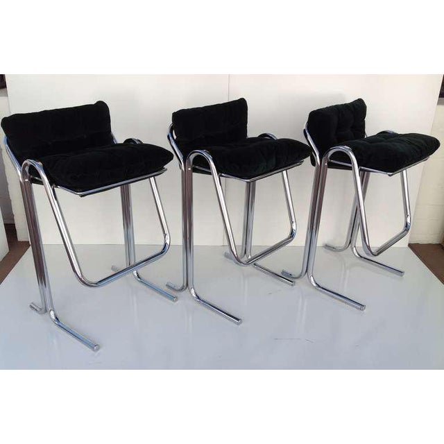 A set of three chrome base bar stools with plush green loose seat and back cushions designed by Jerry Johnson. Circa 1960s