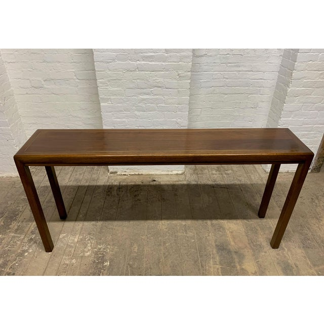 Walnut and brass inlay console table by Baker Furniture Company.