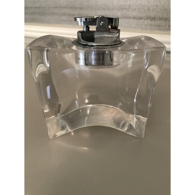 Sculptural and abstract in shape this heavy lucite lighter with chrome accents is a beauty. No chips. A few very minor...