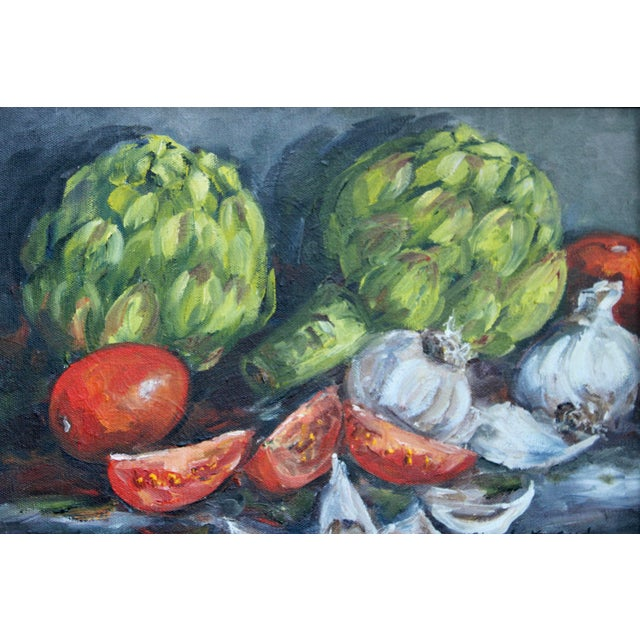 A fine still life oil painting of artichokes, tomatoes, and garlic; all of the fresh ingredients you need for a delicious...
