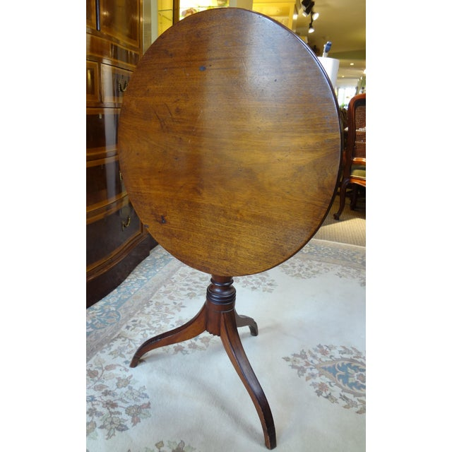Here we have a George III tilt top tea table. The table is late 18th century to early 19th century. The wood is mahogany....