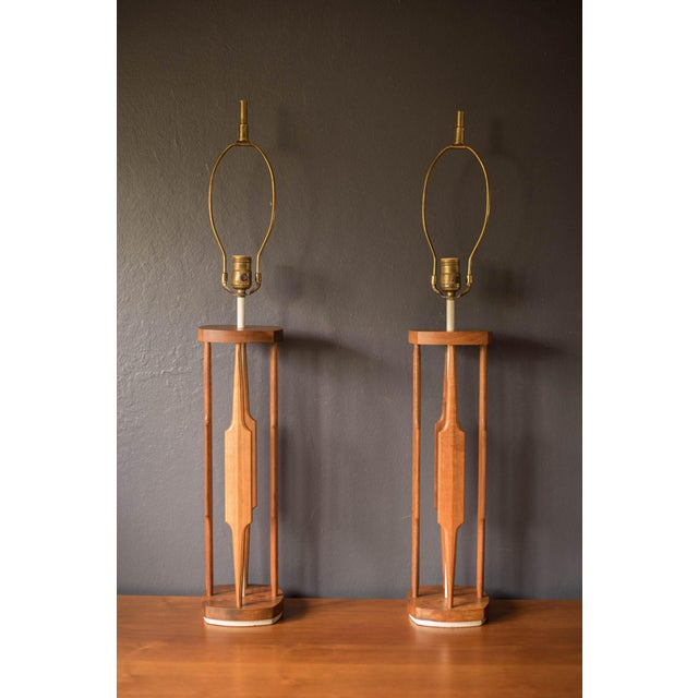 Vintage set of accent lamps designed by Tony Paul for Westwood Industries. This pair features a tall walnut sculptural...