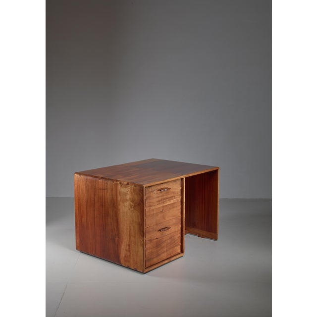 A small wooden desk by Californian craftsman Jim Sweeney. The desk has two large drawers with beautifully sculpted...