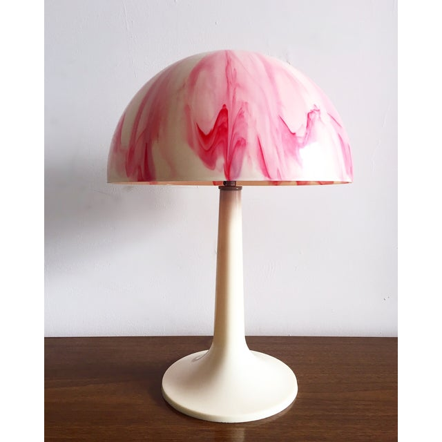 Super funky and cool plastic mushroom lamp with pink swirls. Great Mid-century statement piece. Works great.