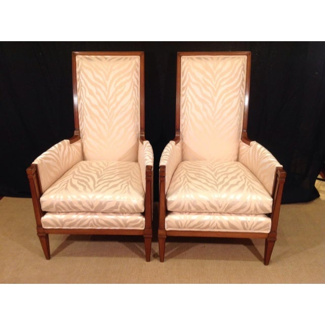 Pair of mid-century modern walnut bergeres. Made in U. S. A. New fabric and upholstery.