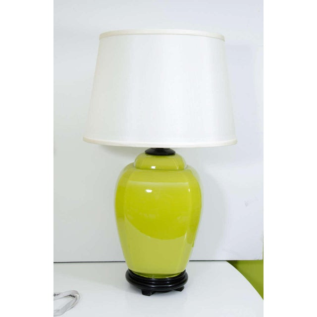 A pair of glass jar lamps in acid green on black wood base with linen shades. These are a nice size and perfect for adding...