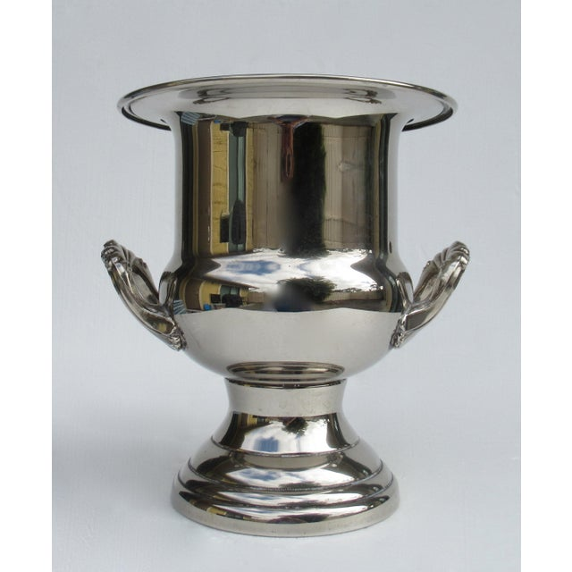 Vintage: 1960s, Silver plate, handled champagne, or wine bucket holder, with ornate handles. On the underside lies, the...