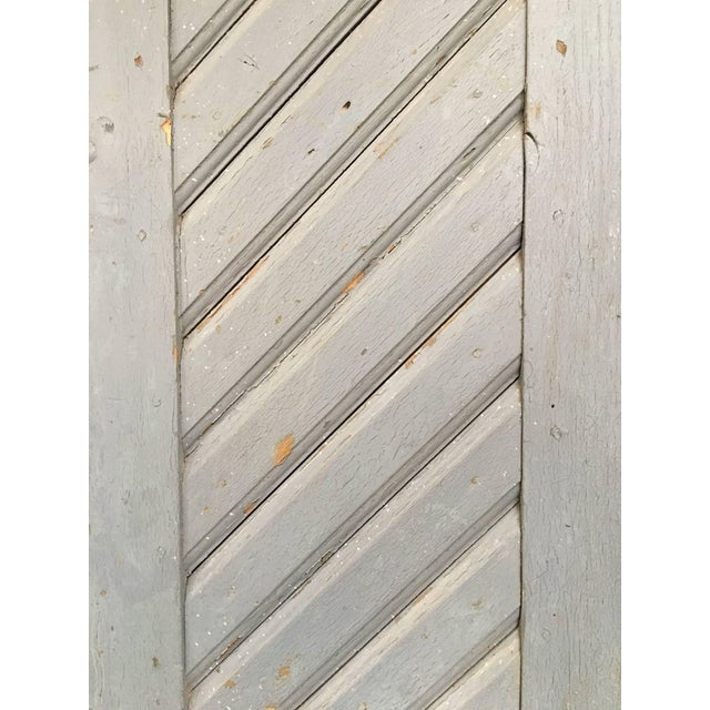 Beautiful rustic painted doors with iron hardware, sourced from a farm in France. There is some wear in back corners, but...