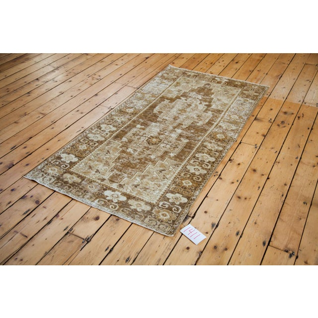 Distressed vintage mid-century Oushak rug from Turkey featuring bronze field, double medallion and distressed aesthetic....