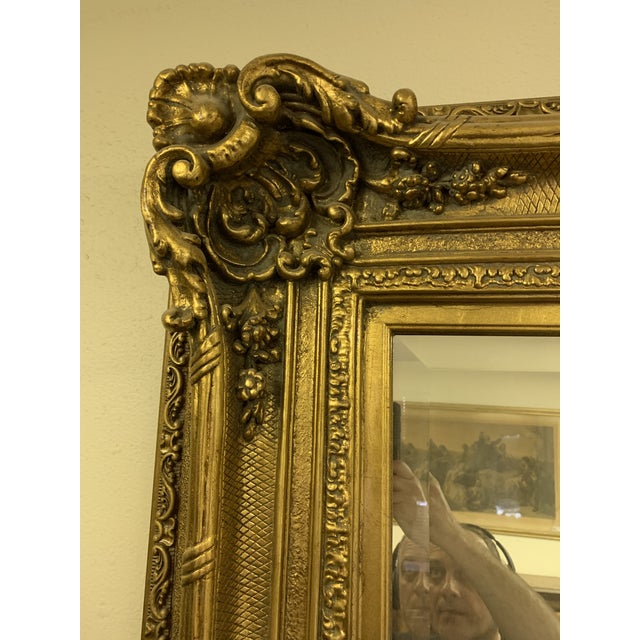 Gorgeous large Louis XIV style floor mirror. Beveled glass and gold leaf frame. Very well made. This piece was acquitted...