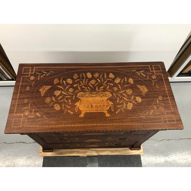 Early 19th century Dutch hardwood inlaid chest of drawers. Three stacking drawers with a top cantilevered drawer. Inlaid...