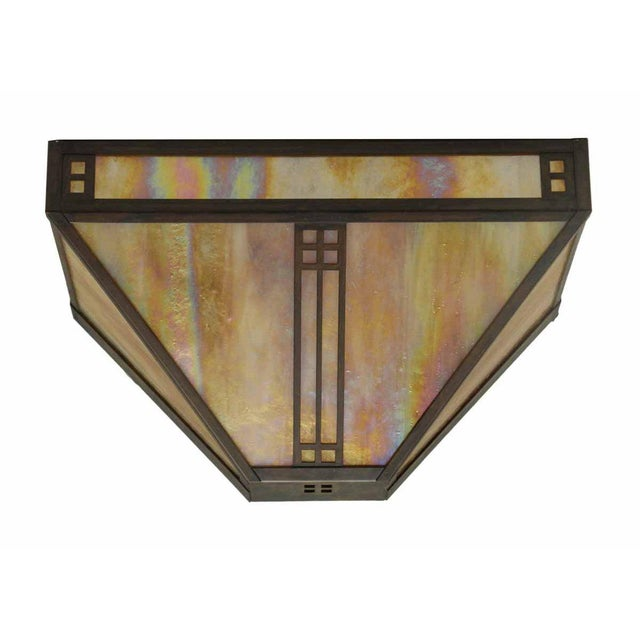 This is a newly wired sconce light with pretty iridescent stained glass. Requires two bulbs. In excellent condition. Made...