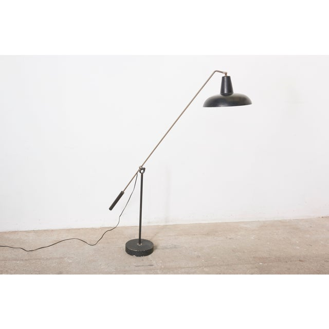 Early model of a counter balance floorlamp from J.J.M. Hoogervorst for Anvia. The shade and arm are adjustable in all...