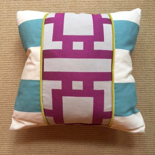 This cotton blend pillow is handsome because of the geometric lines it processes. The robin blue ans the orchid purple is...