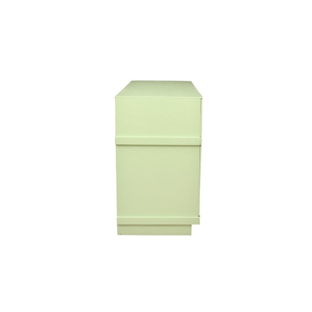 1950's mid century Basic-Witz china cabinet painted pale green. The case holds one upper drawer made to look like four,...