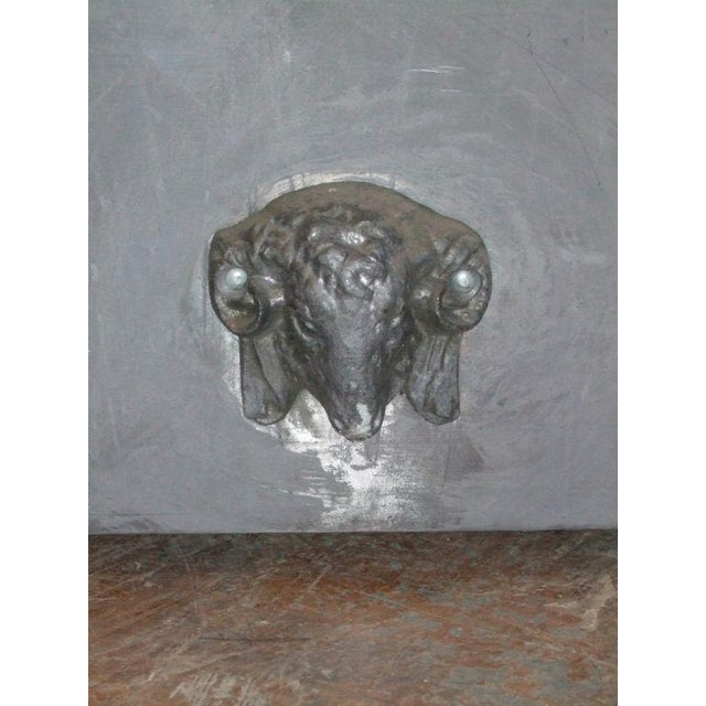 Large zinc planter with ram's head and removable top.